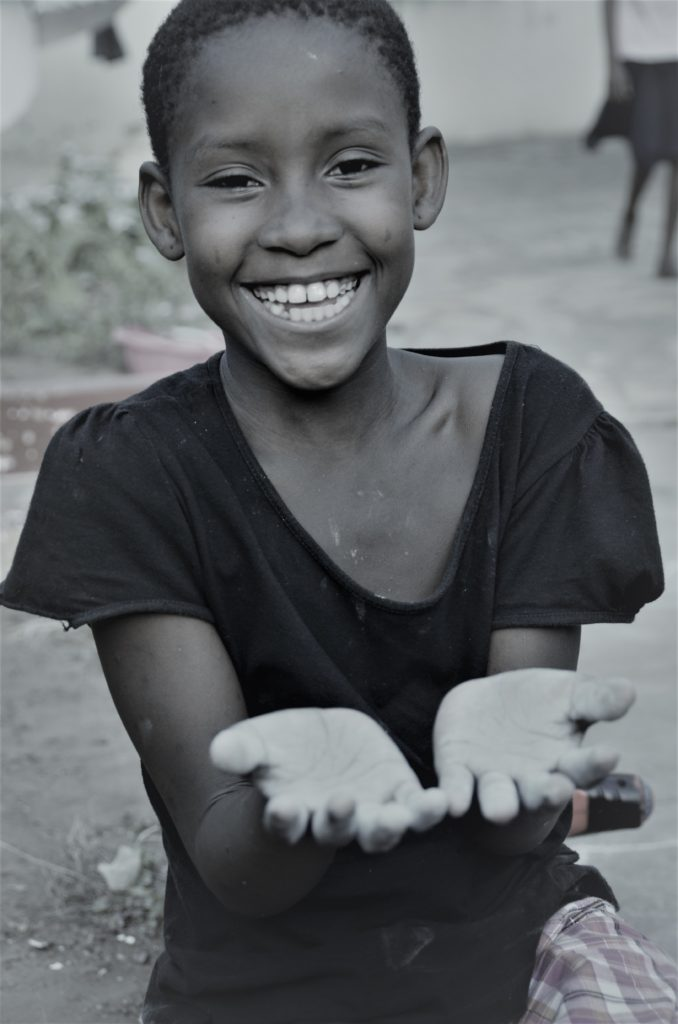 Girl smiling with outstretched hands