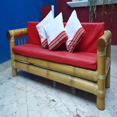 Bamboo couch with red cushions